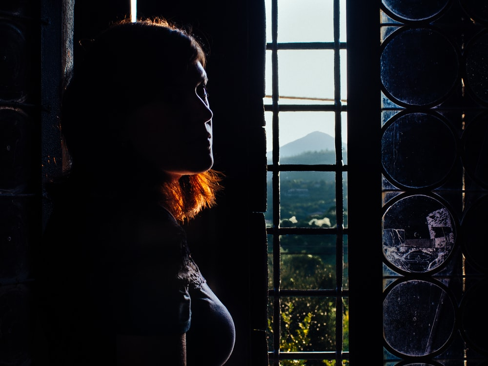 woman leaning wall taken inside room