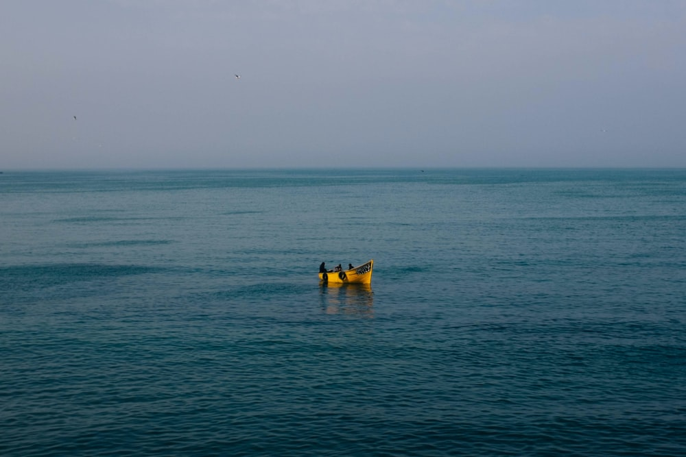 landscape photography of yellow floater floating on sea