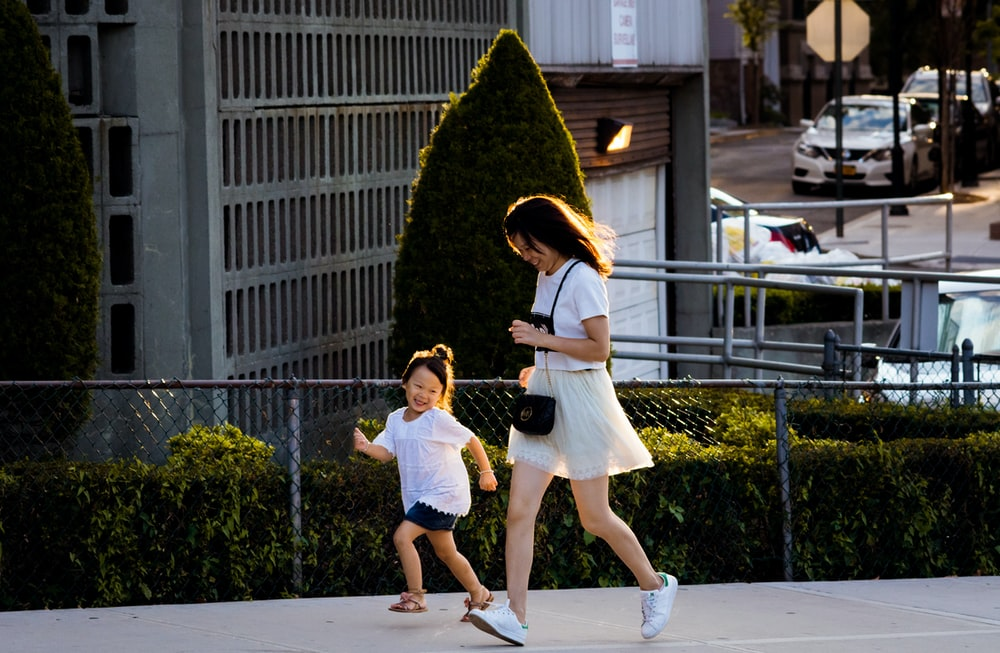 time lapse photography of man and girl running