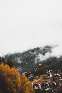 assorted houses beside mountain during daytime