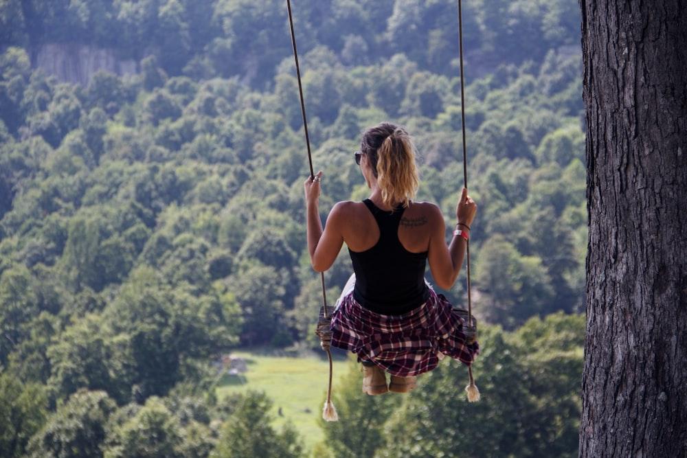 woman riding on swing