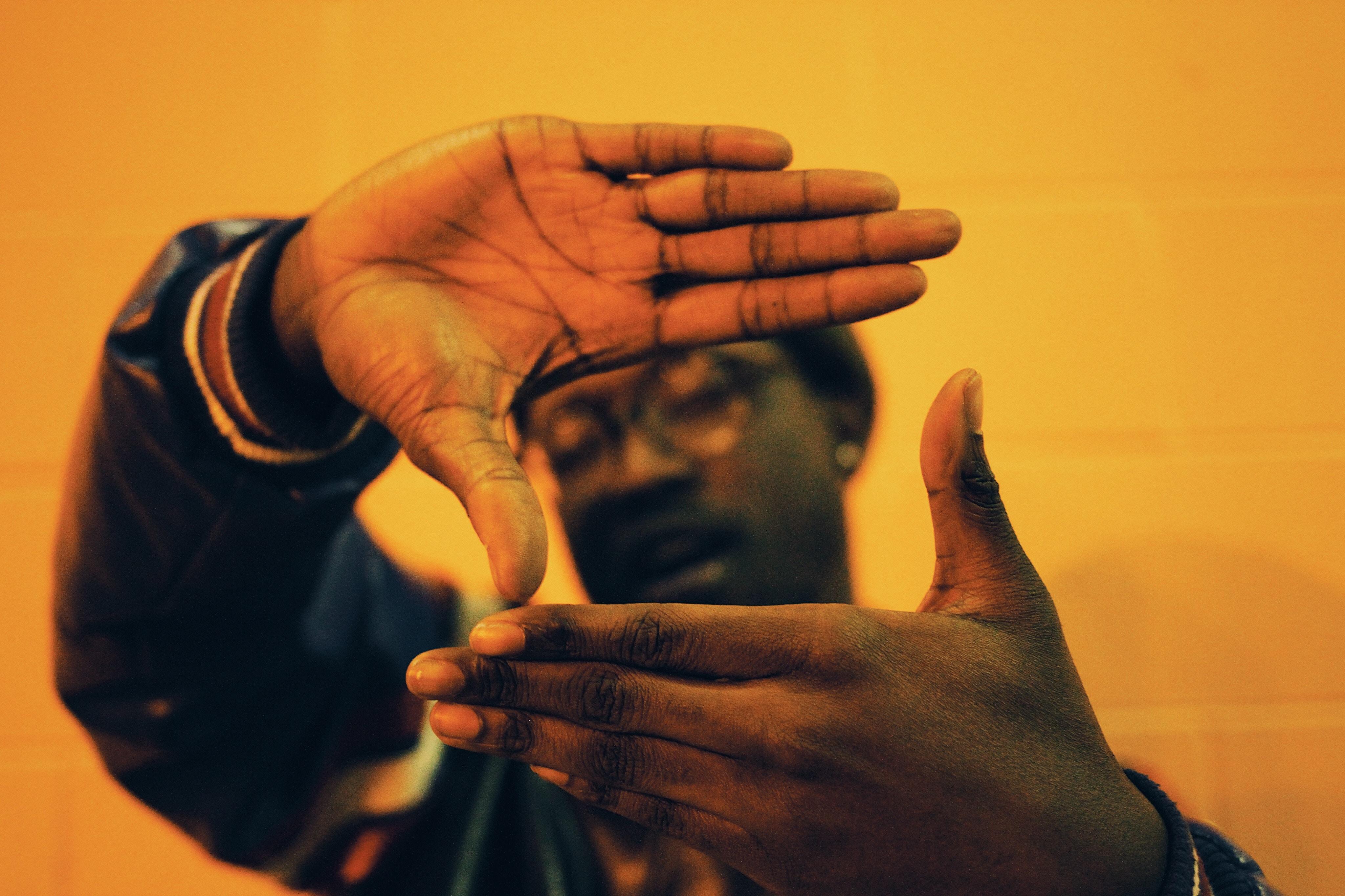 man doing hand gesture