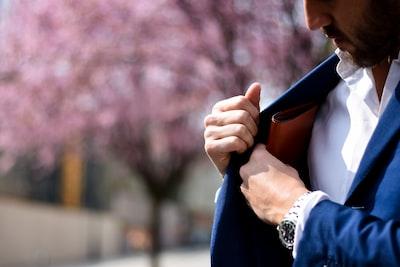 man putting wallet on suit pocket