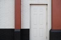 white wooden 6-panel door