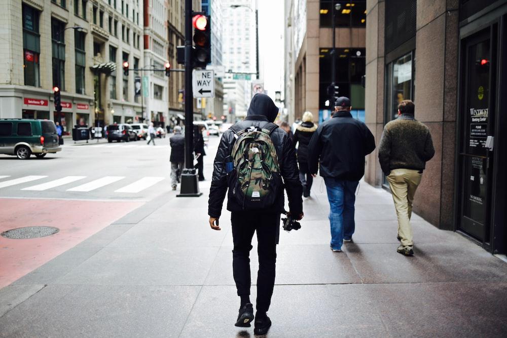 men walking on pathway beside building