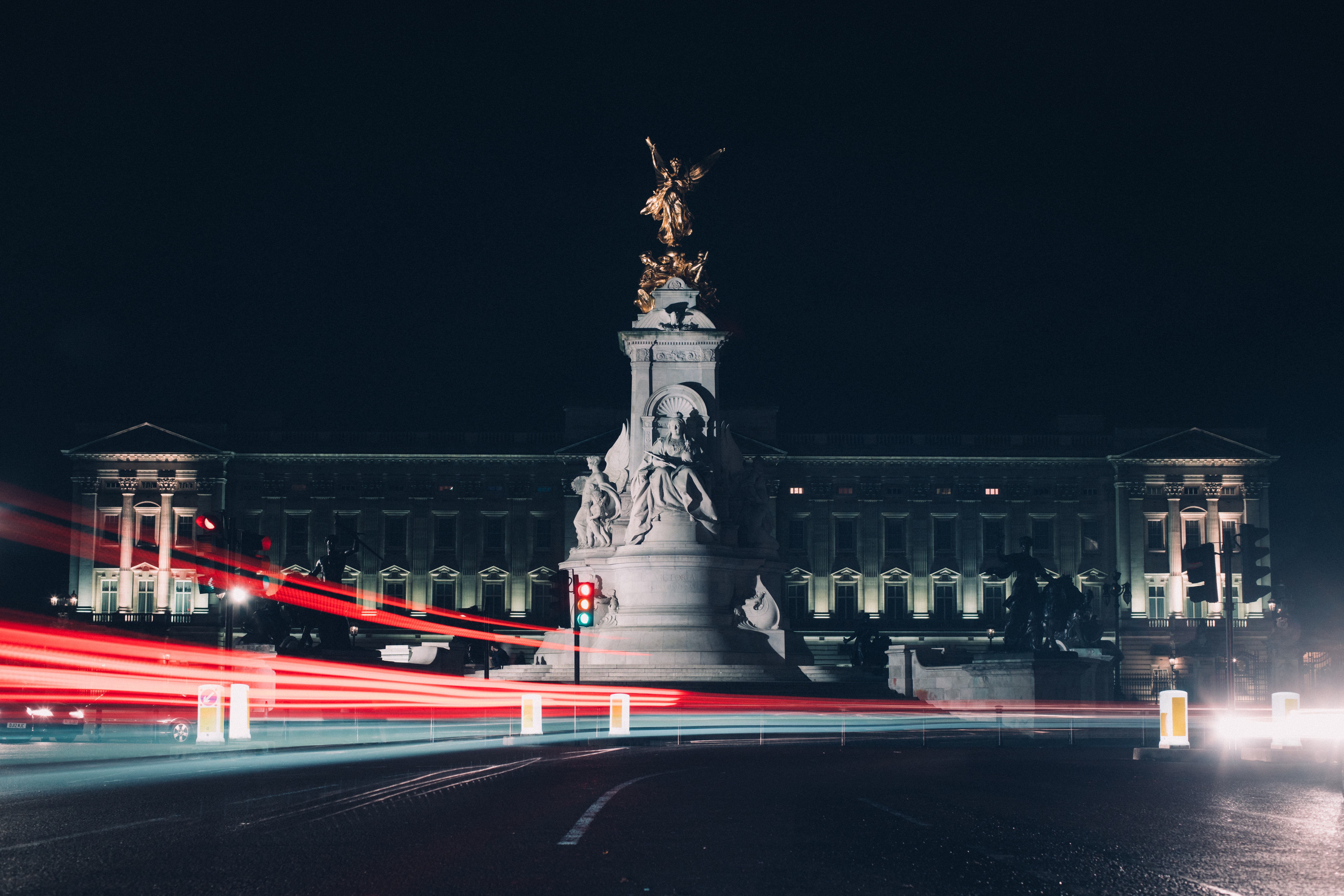 time lapse photography of gray building and statue