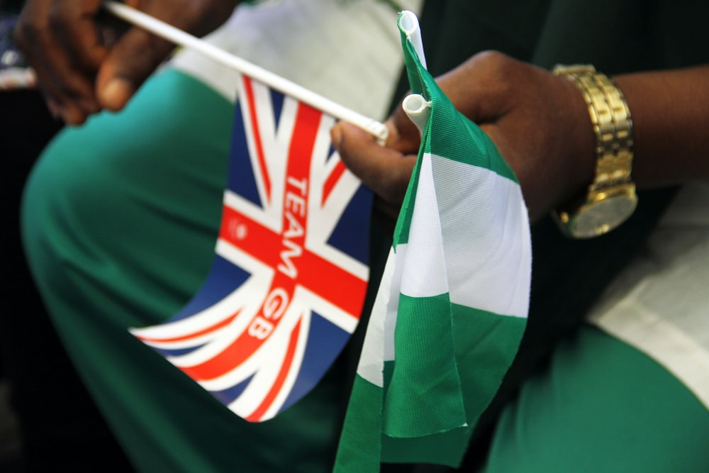 person holding mini flag