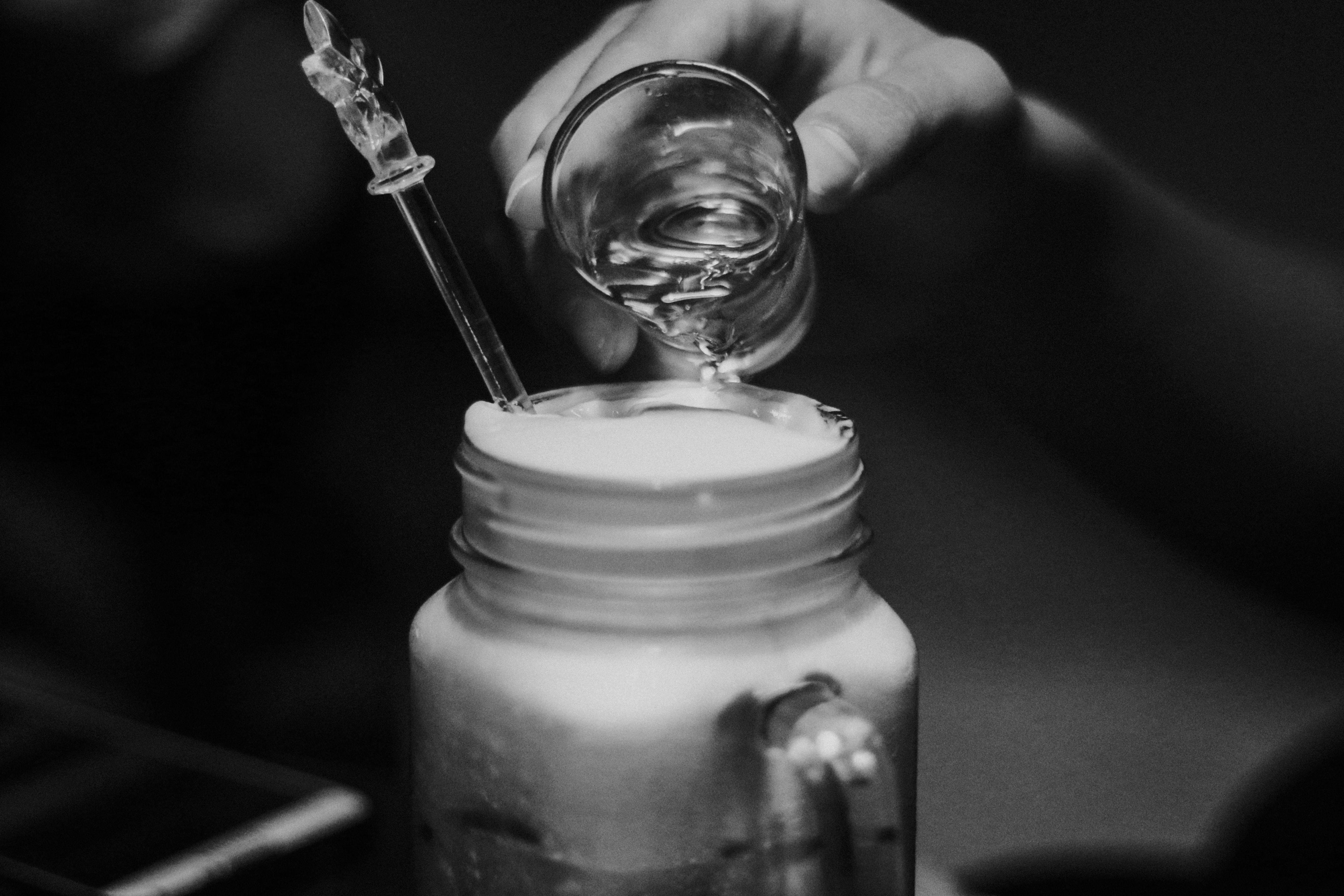 grayscale photography of jar