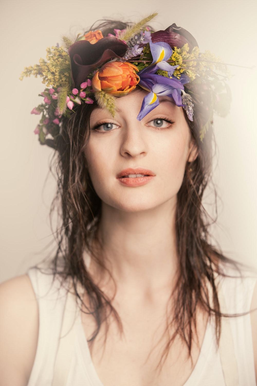 women wearing floral headdress