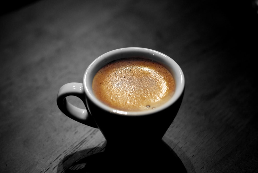 white ceramic coffee mug with capuccino