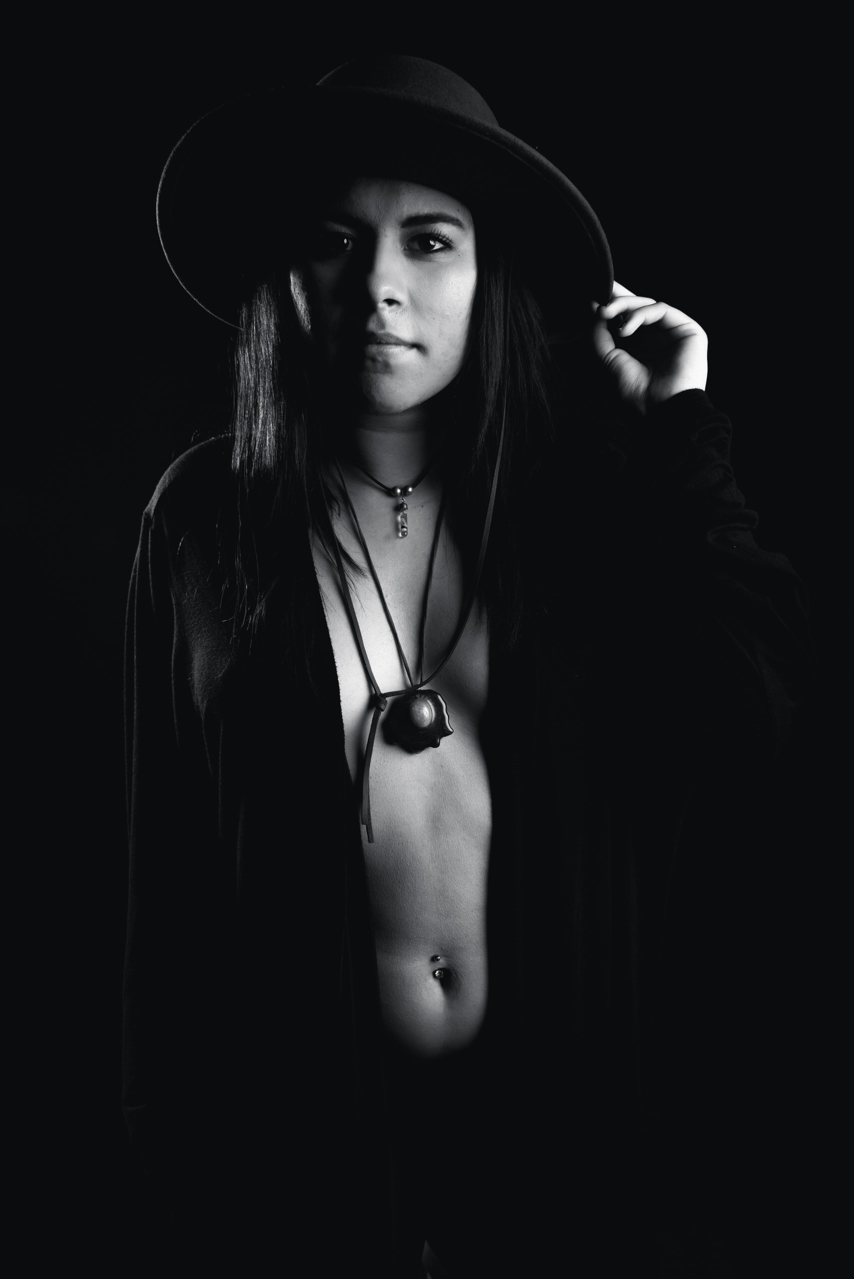 grayscale photography of woman wearing hat