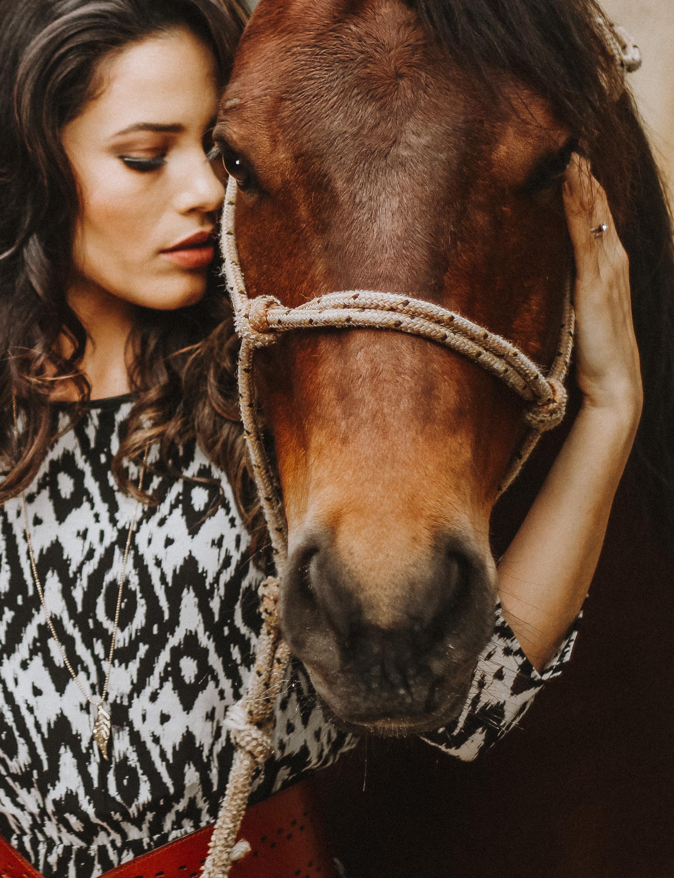 woman holding horse head