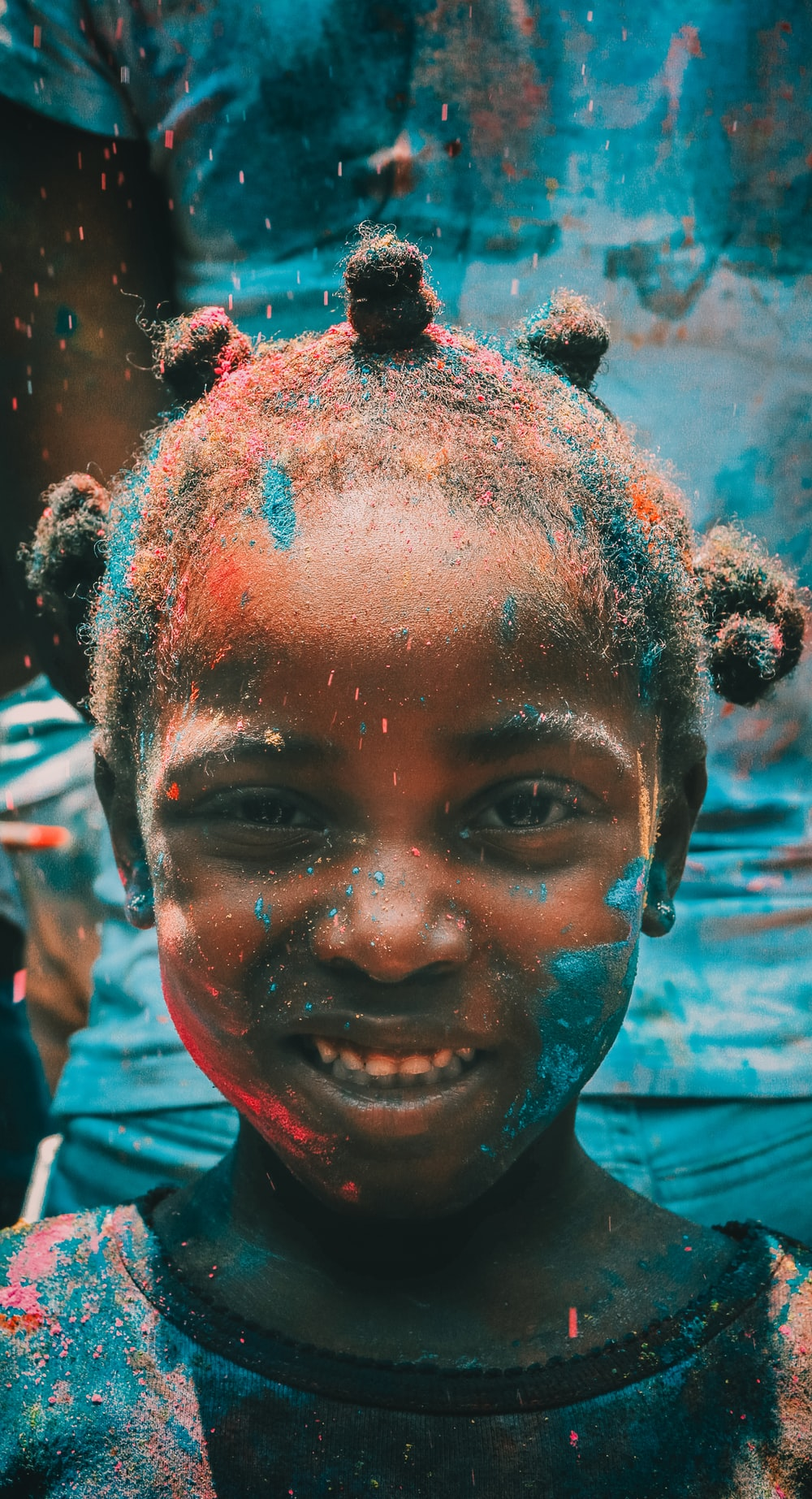 girl covered with holi powder during daytime