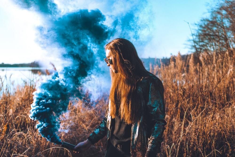 woman holding smoke tool