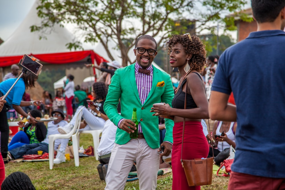 man and woman talking at party