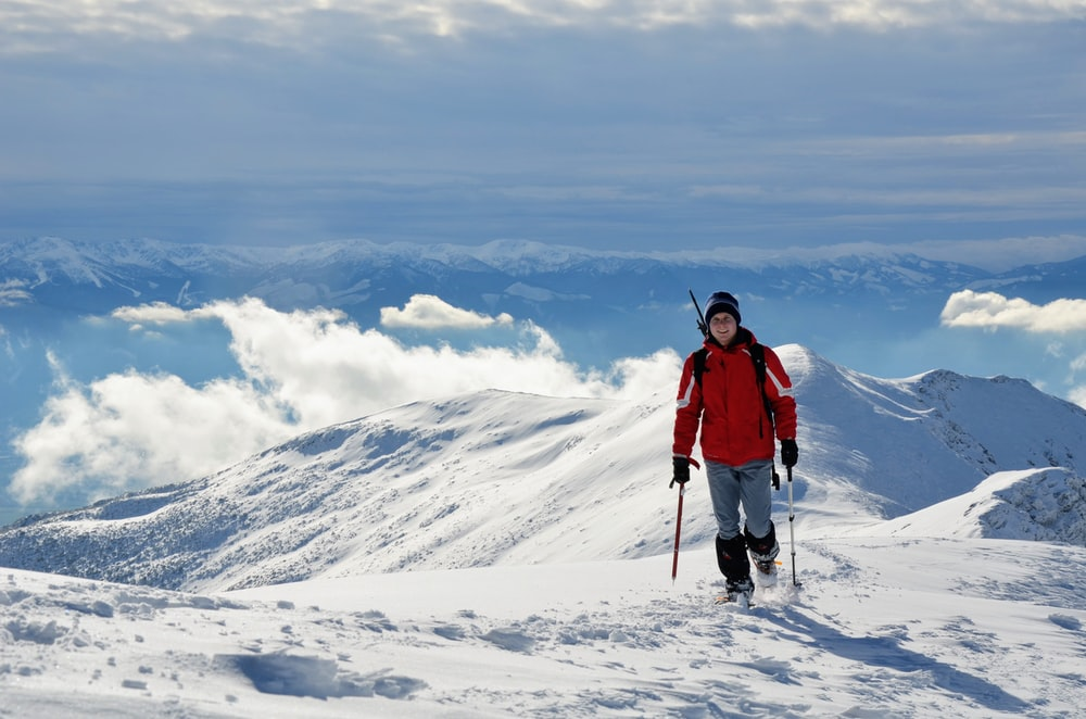 person on snow mountain during daytime