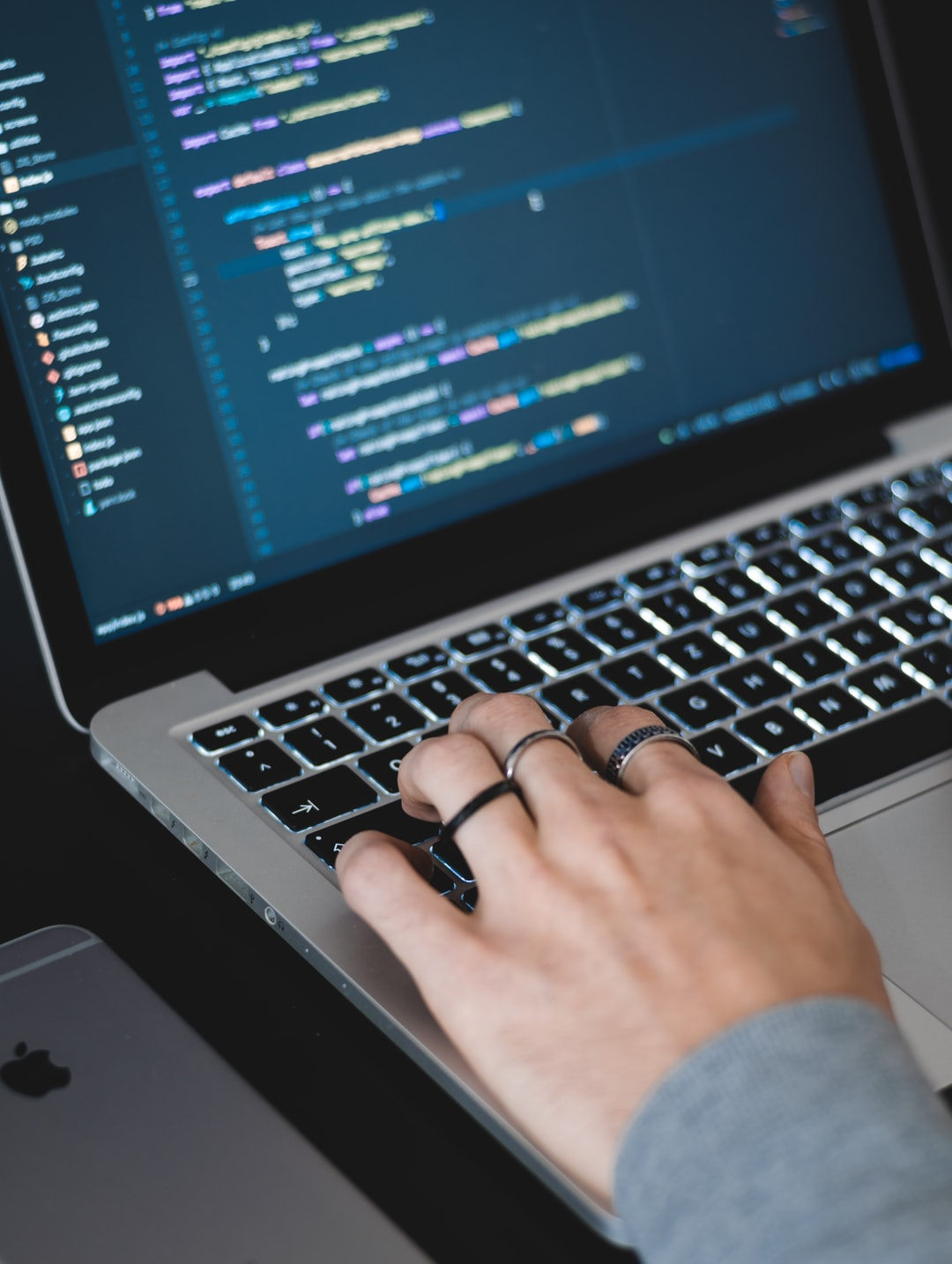 Coder Working on Macbook Pro
