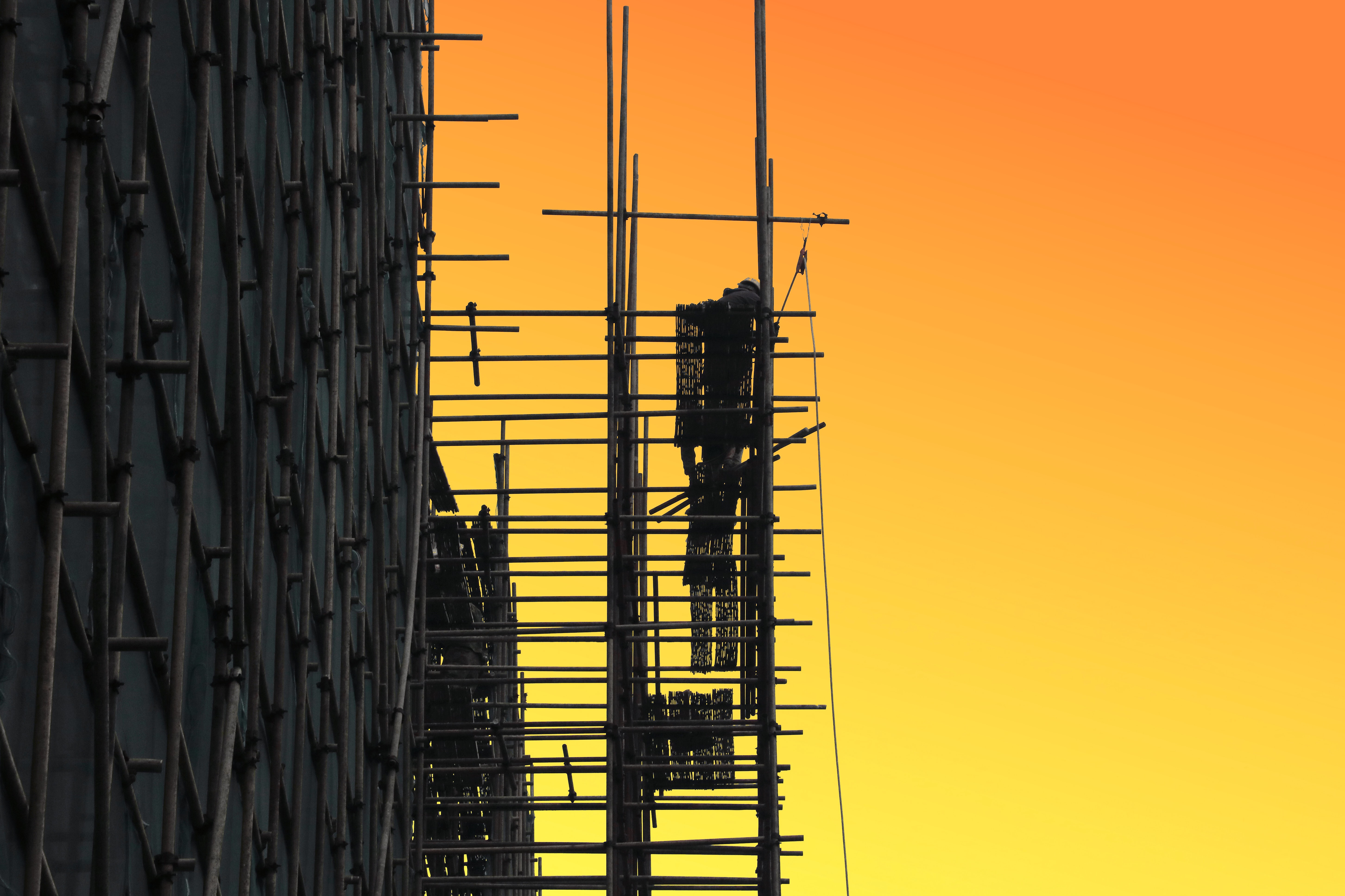 black scaffolding golden hour