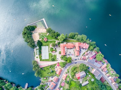 aerial photography village beside sea
