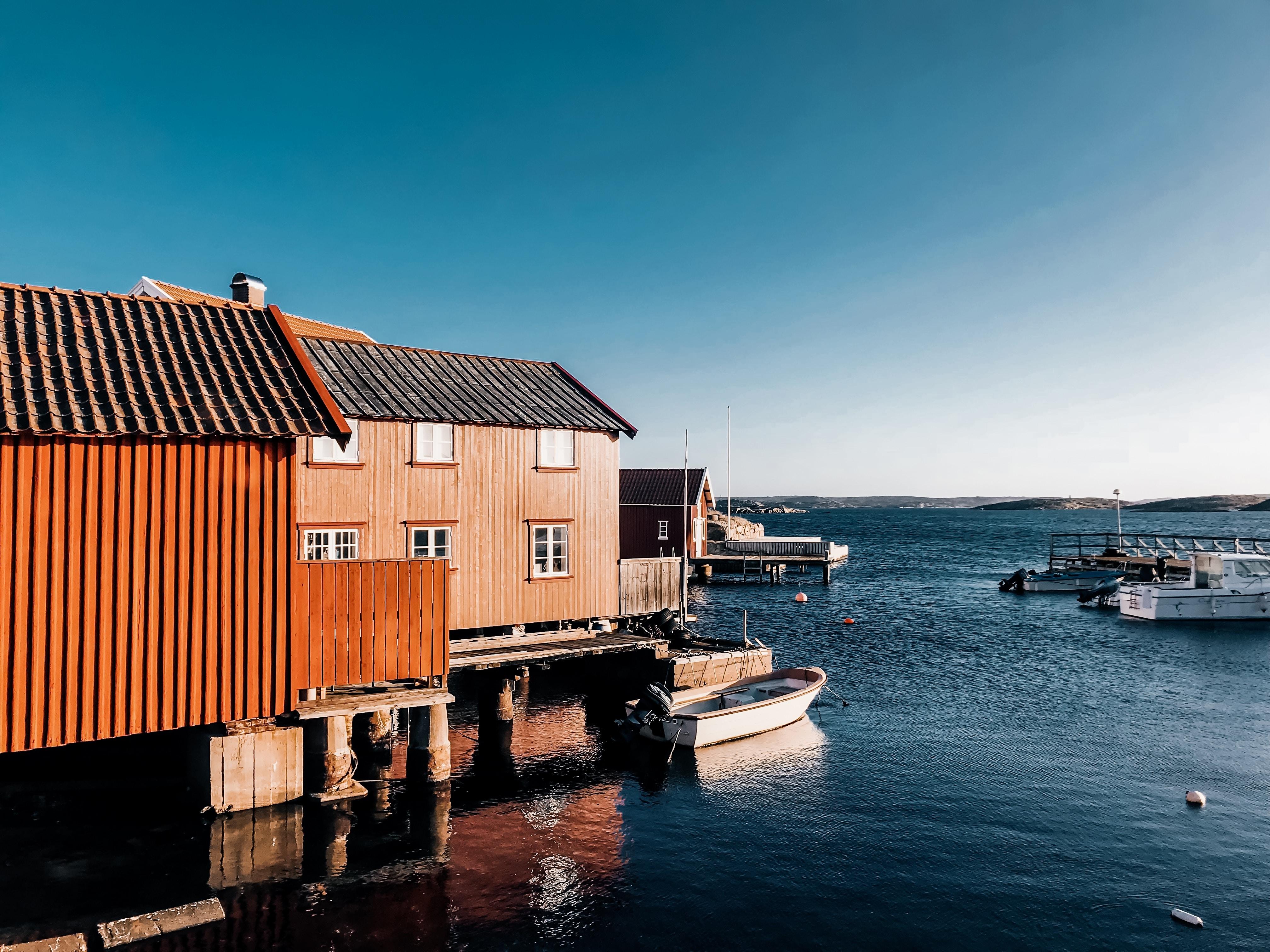 body of water beside boat docks