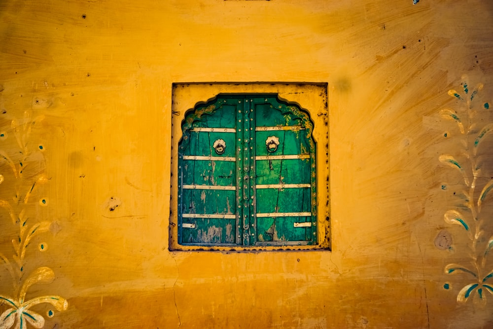 green wooden window painting