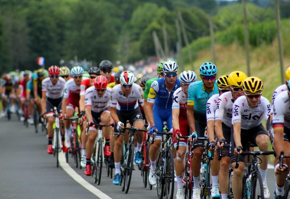 group of men riding bicycle