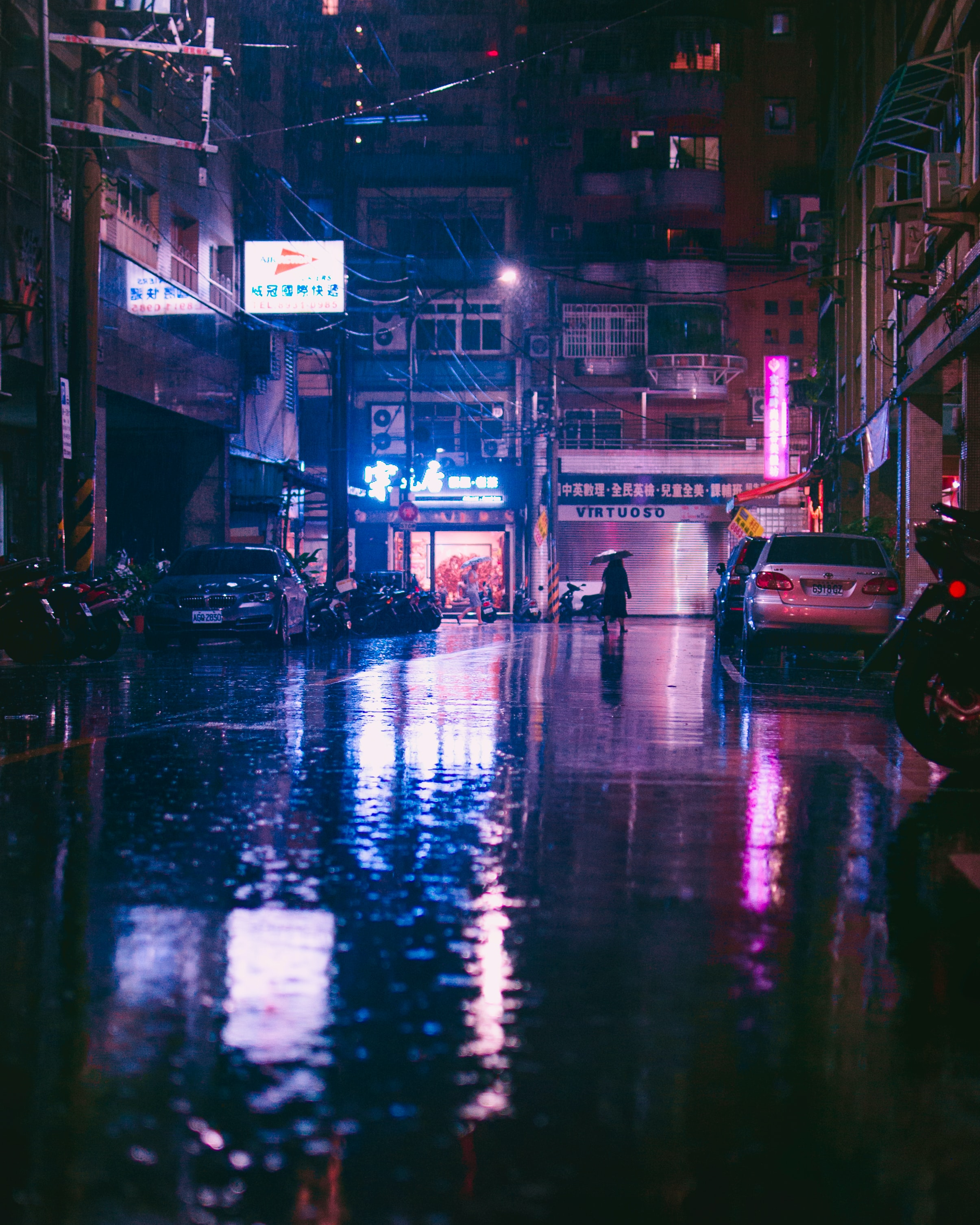 rainy cityscape by night