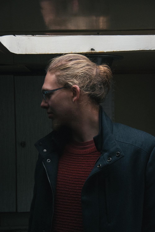 photography of man wearing jacket