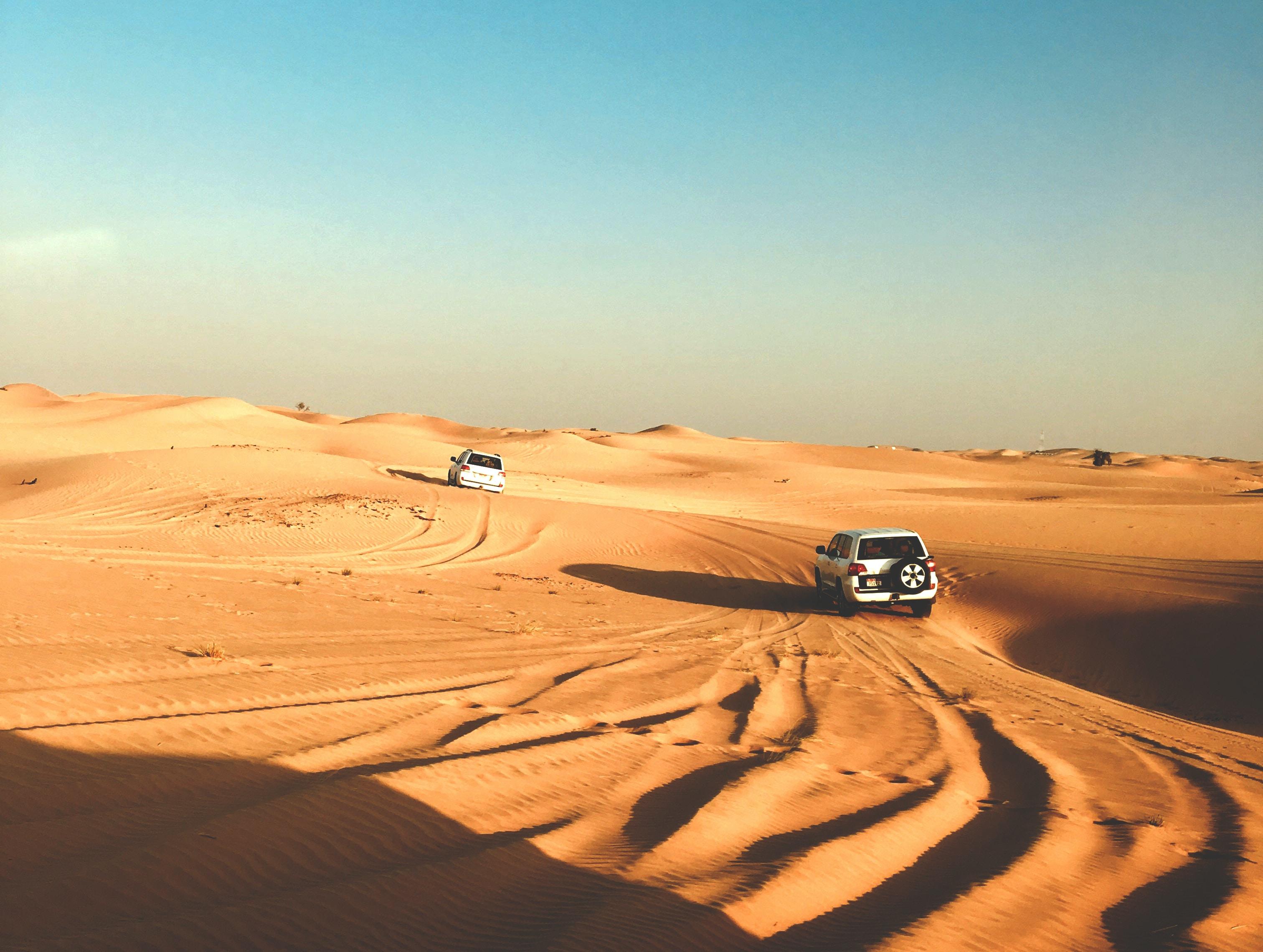 photo of gray vehicle on desert