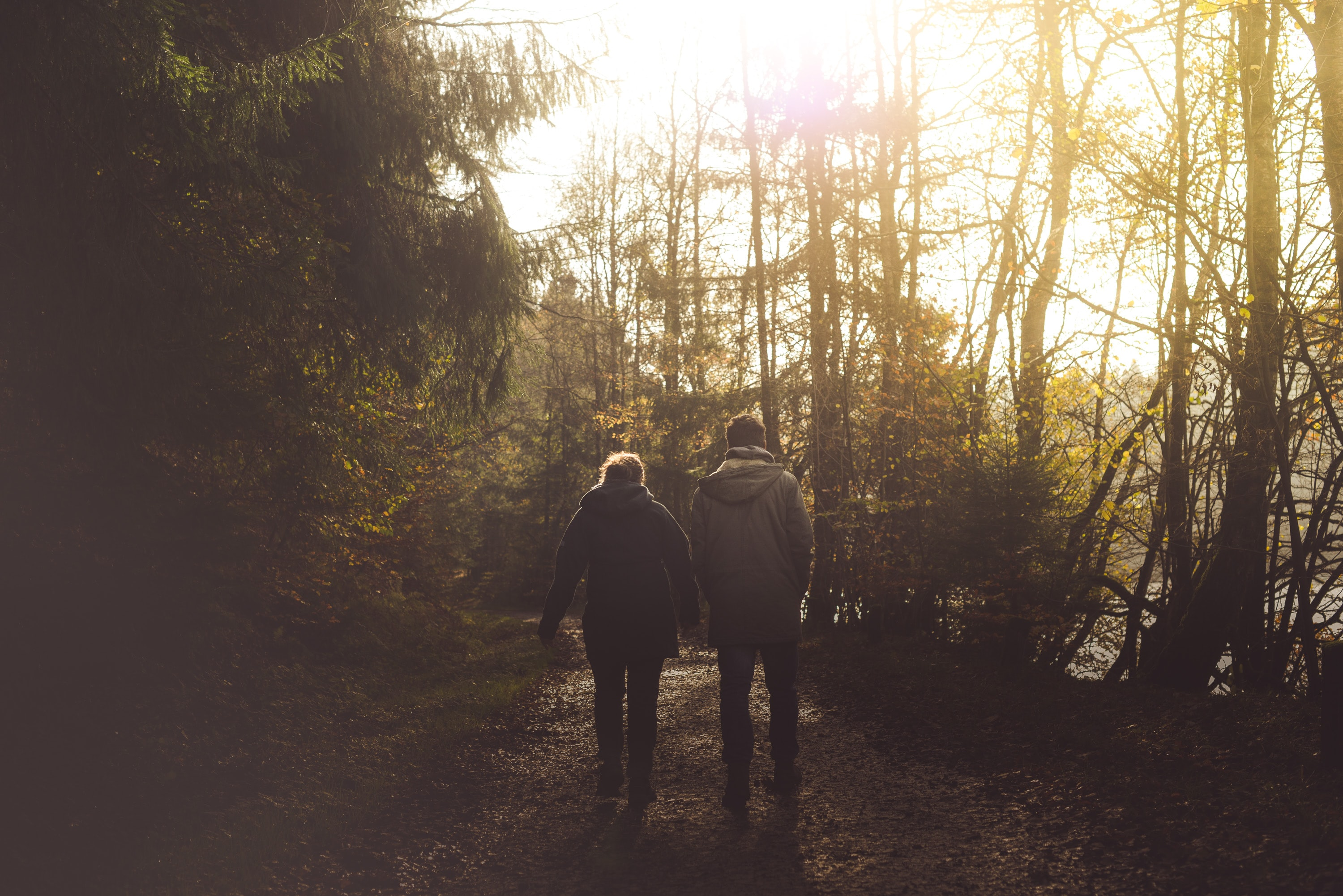 shallow focus photography of of man and woman walking