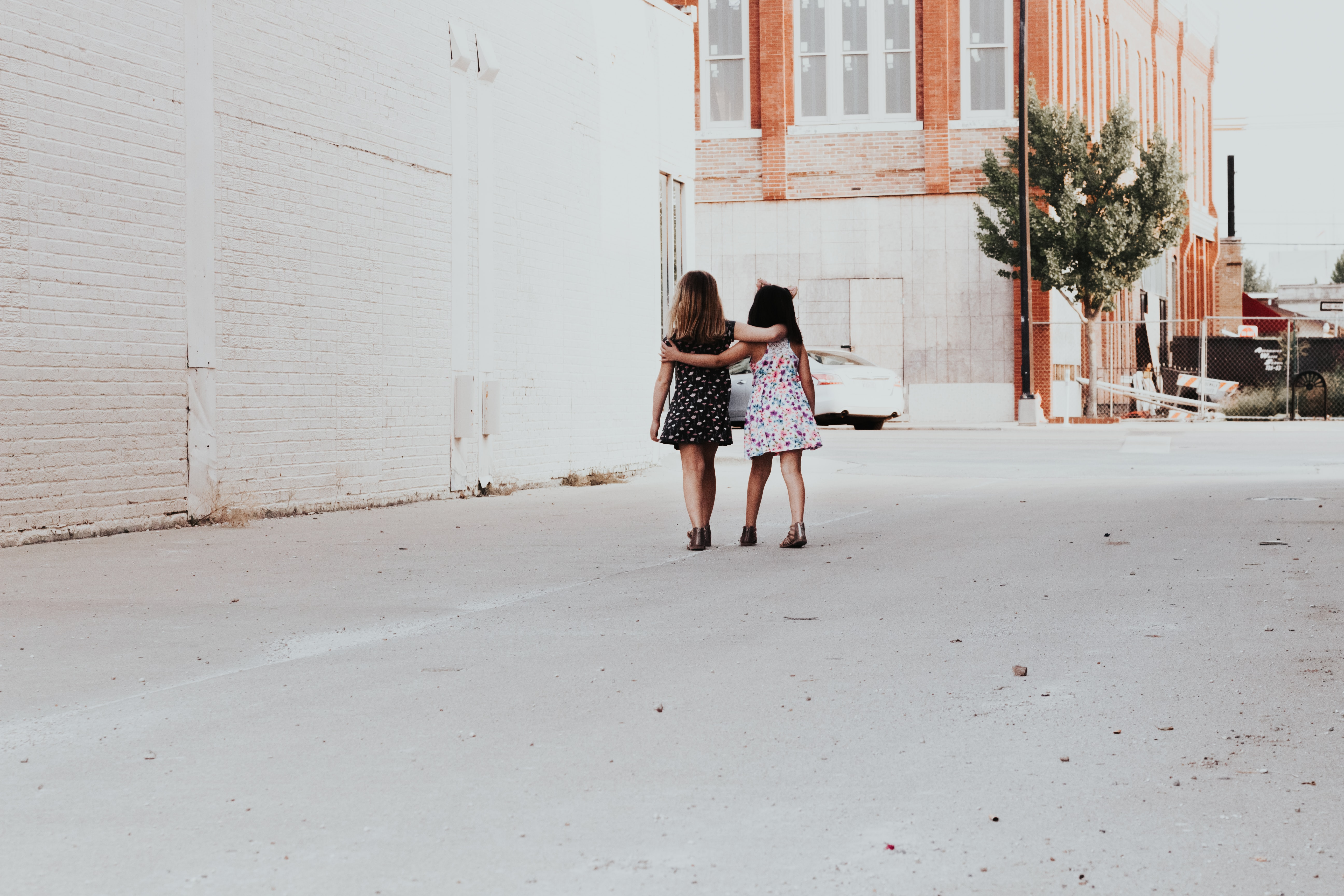 two girls walking on street