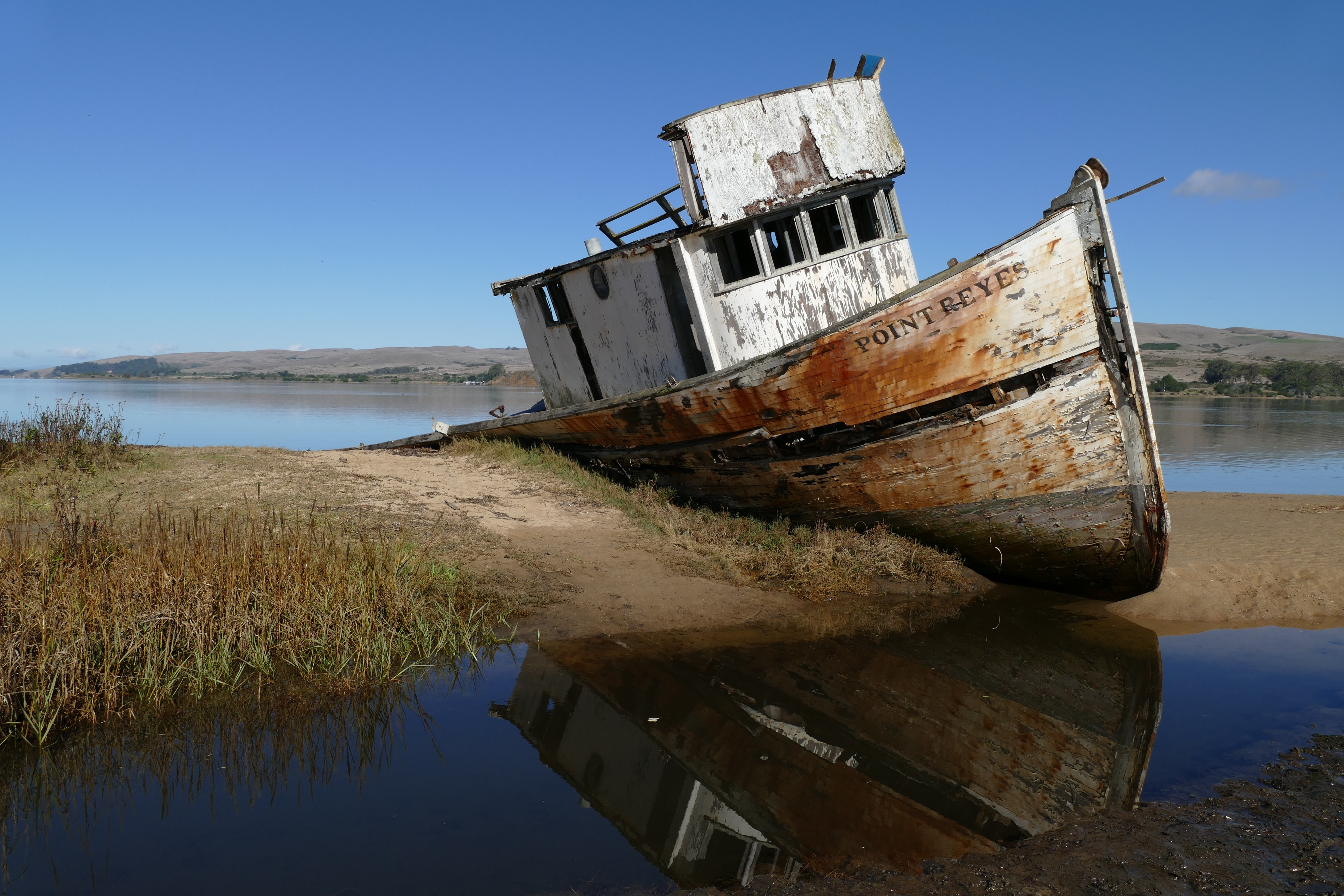 brown-and-white boat on land
