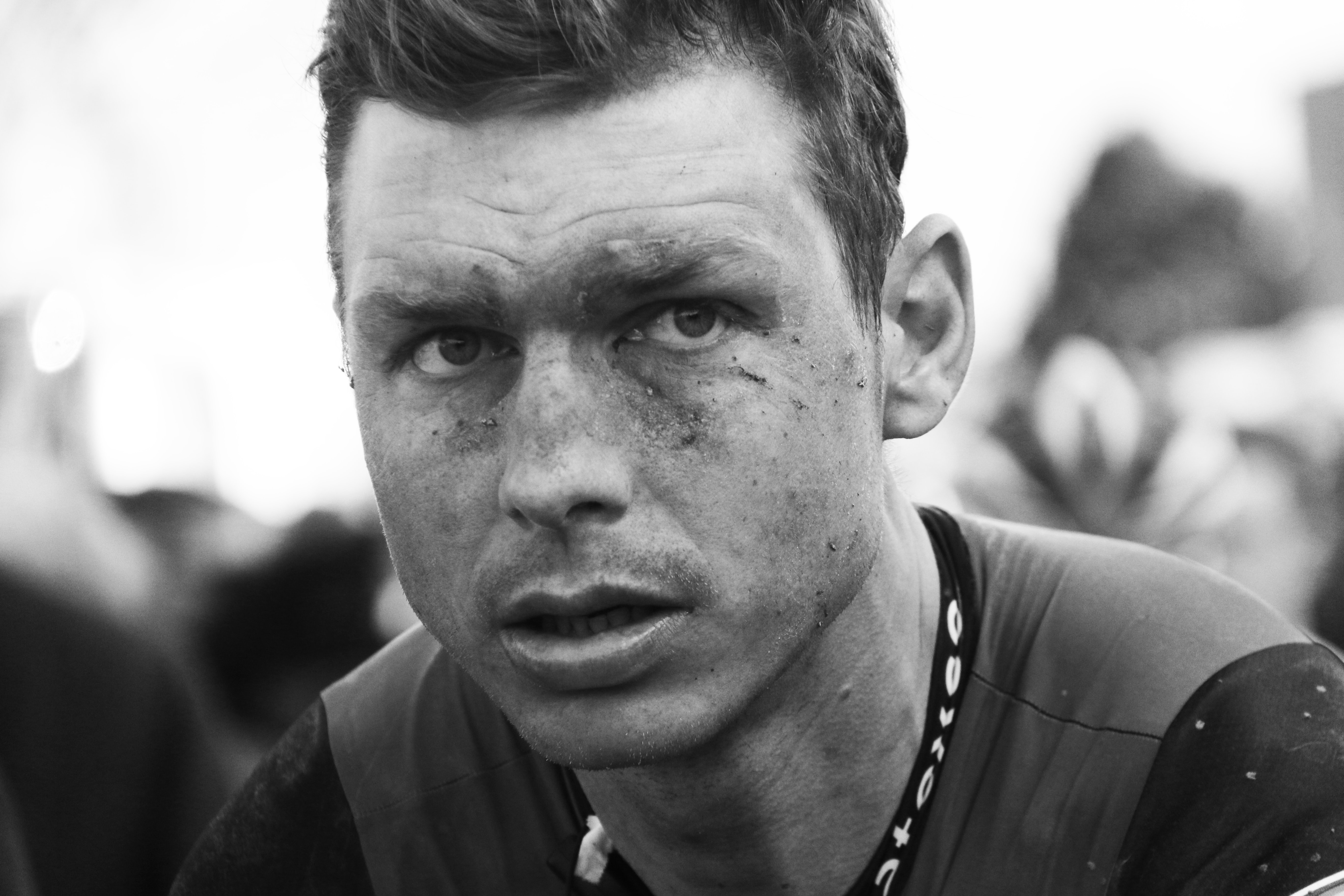 grayscale photo of man with dirty face,