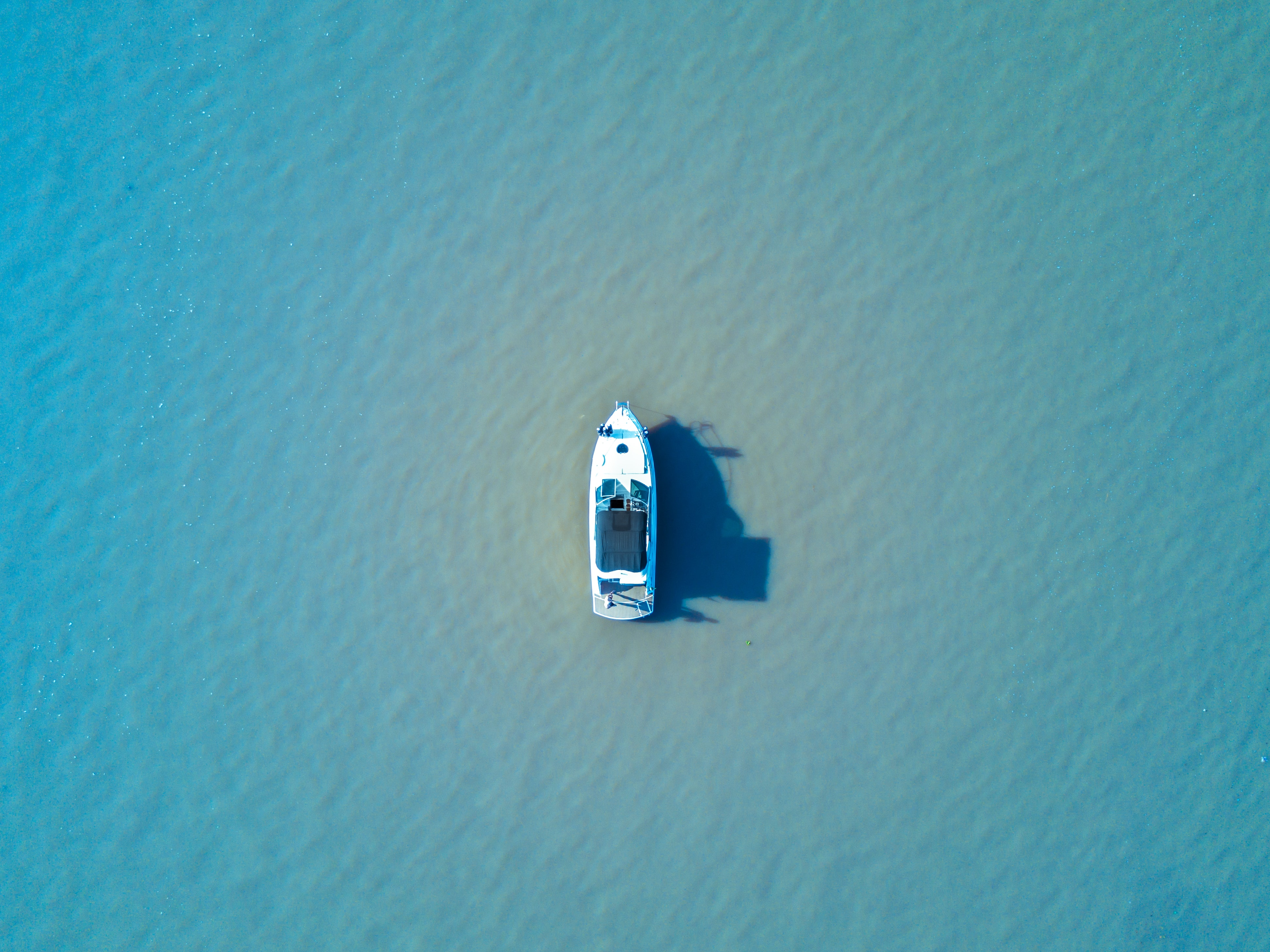 white boat in the middle of the sea during daytime