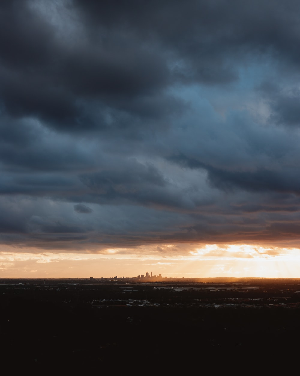 cloudy sky above cityscape