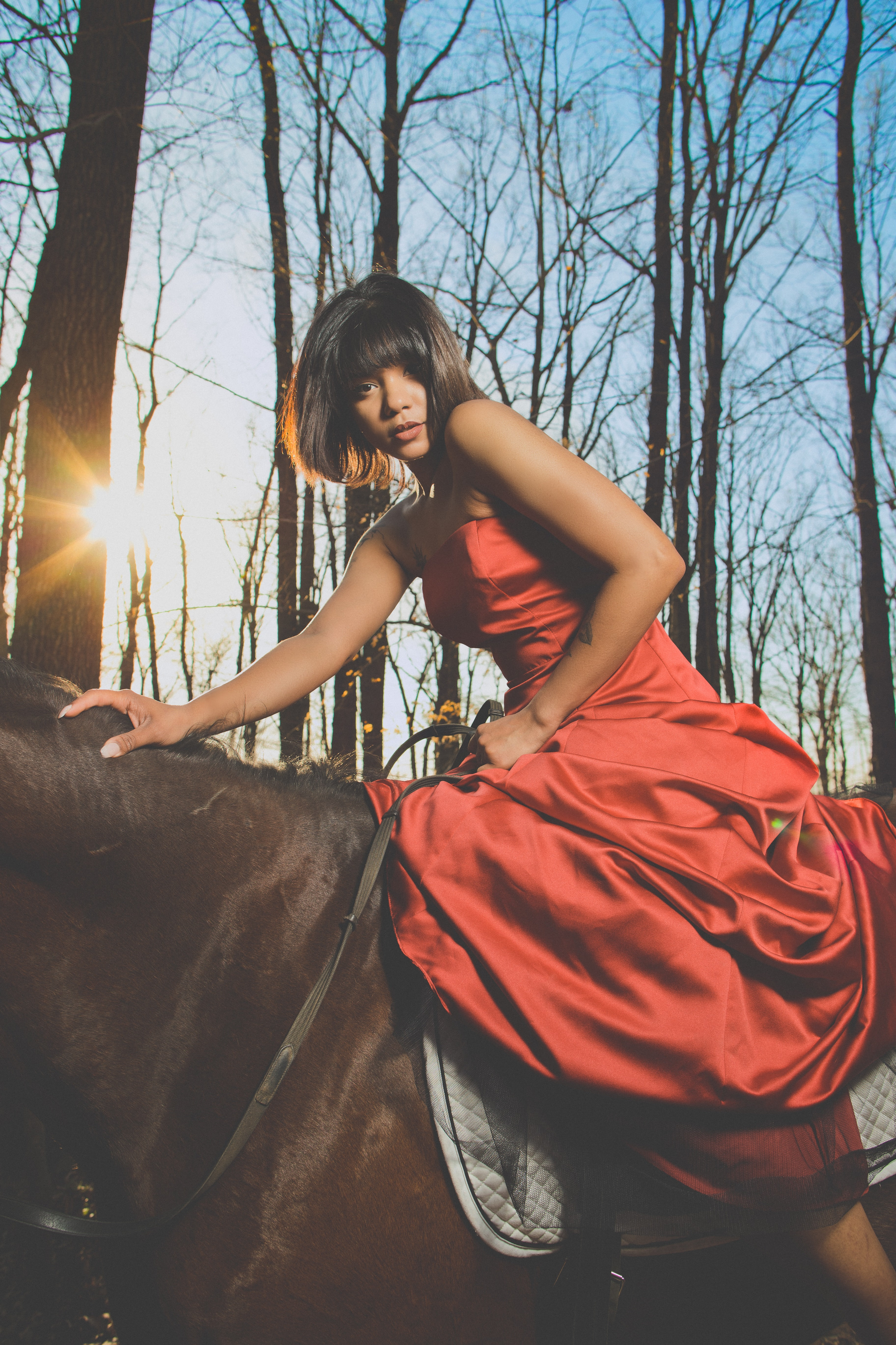 woman rides on horse