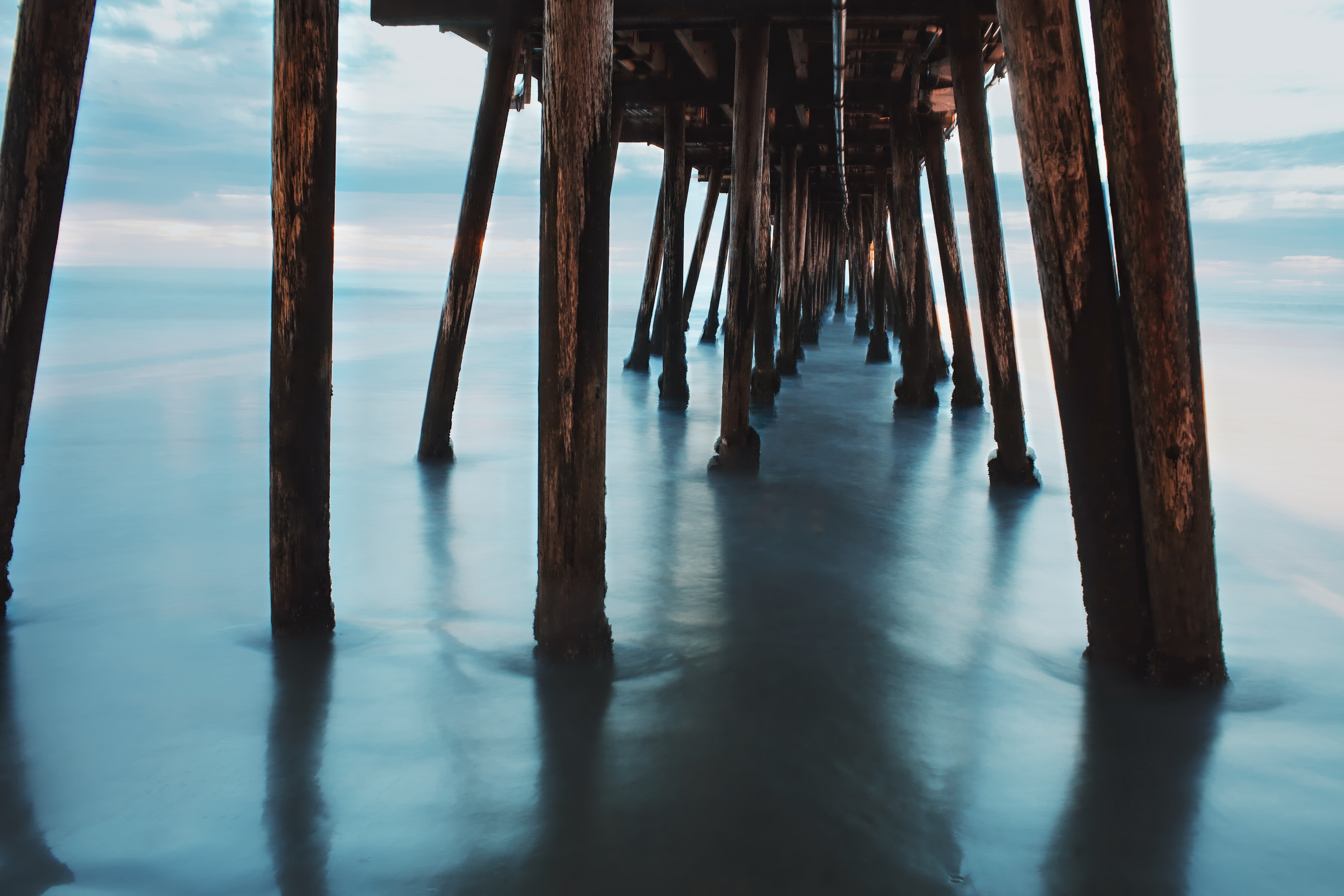 landscape photography of wooden sea dock