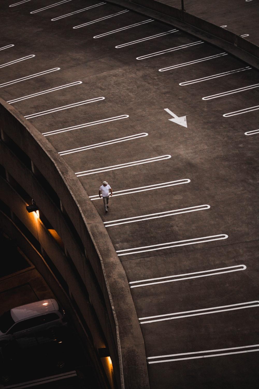 man walking on brown concrete paving