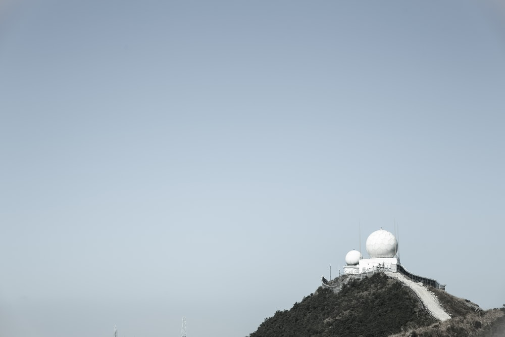 white dome building on top of mountain