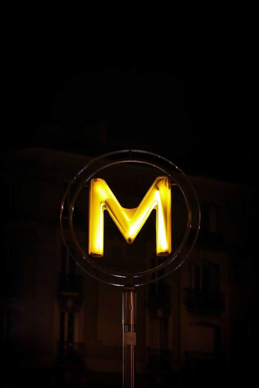 Closeup Photo Of Orange M Neon Signage