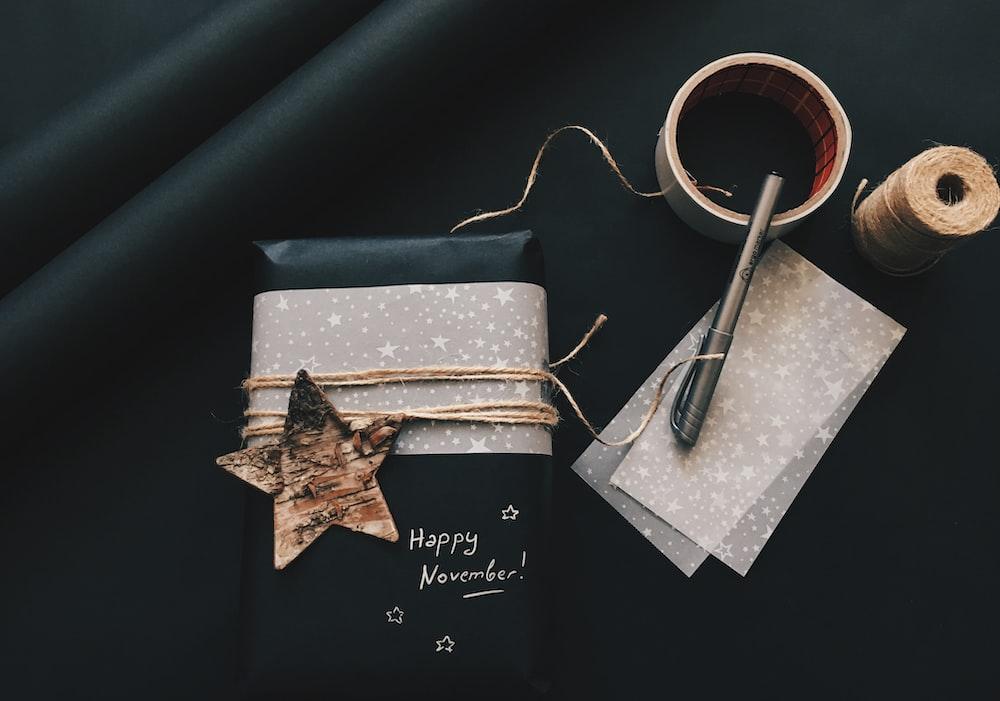 gray pen beside star decor