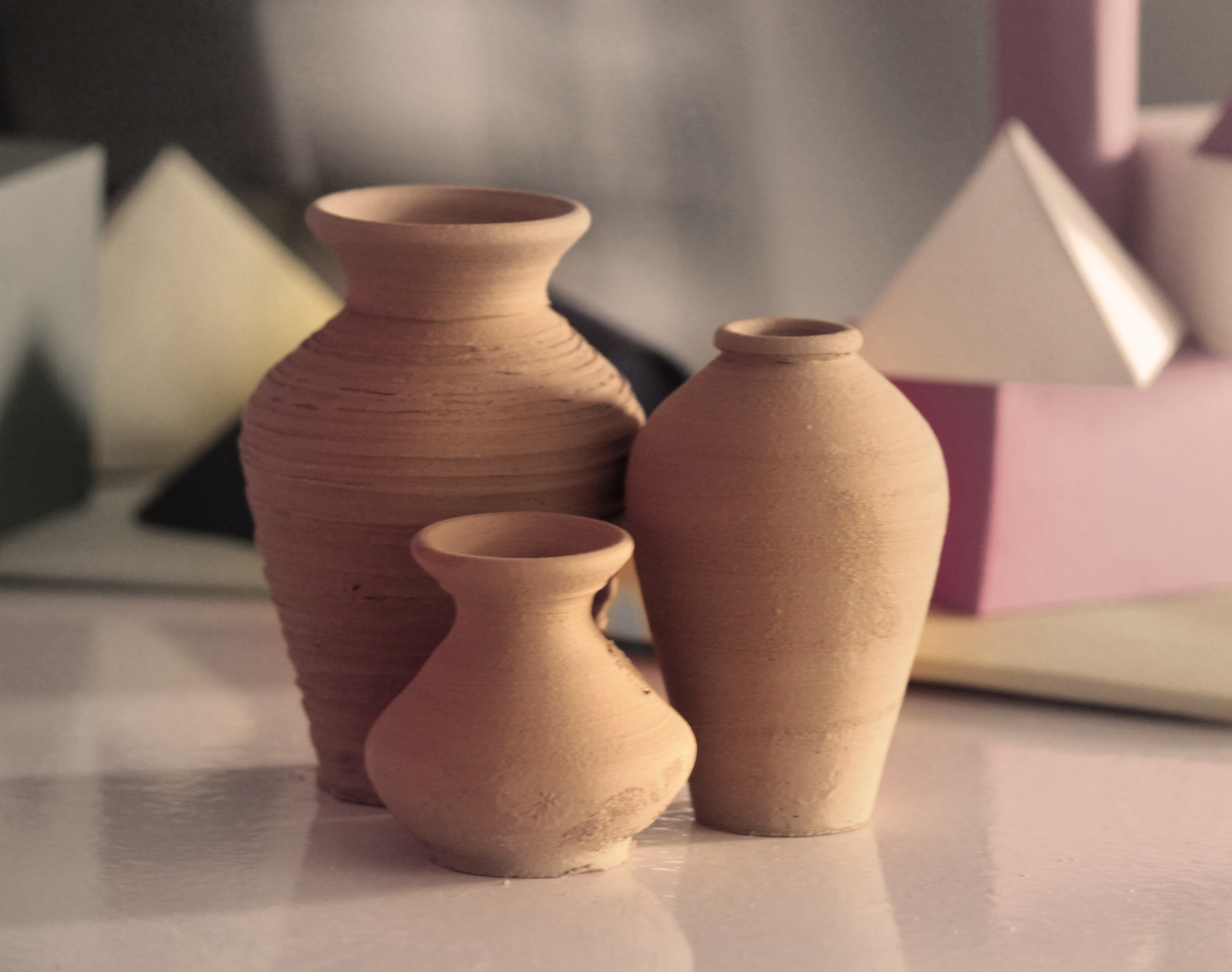 three brown clay vases