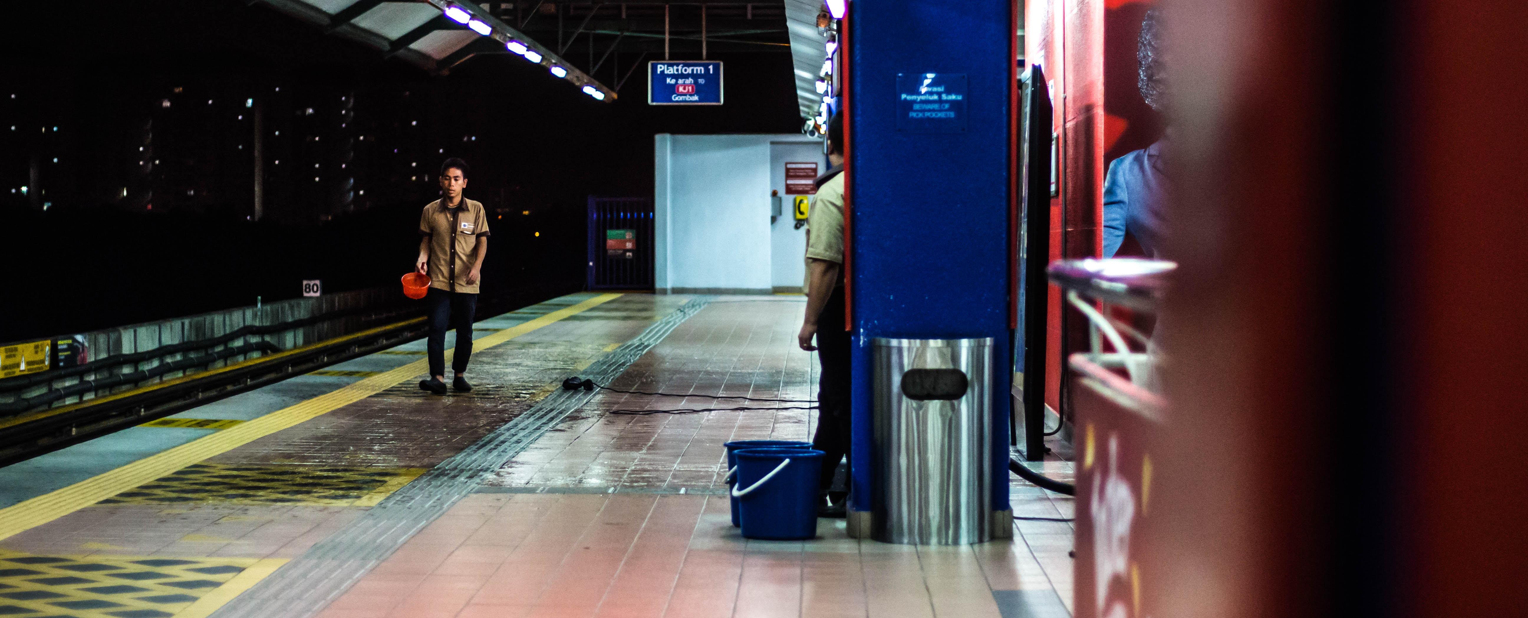 man walking in train station