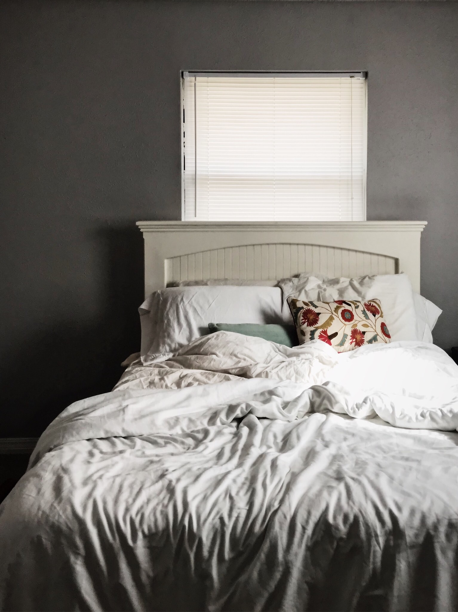 white and gray bed sheet with pillow on bed