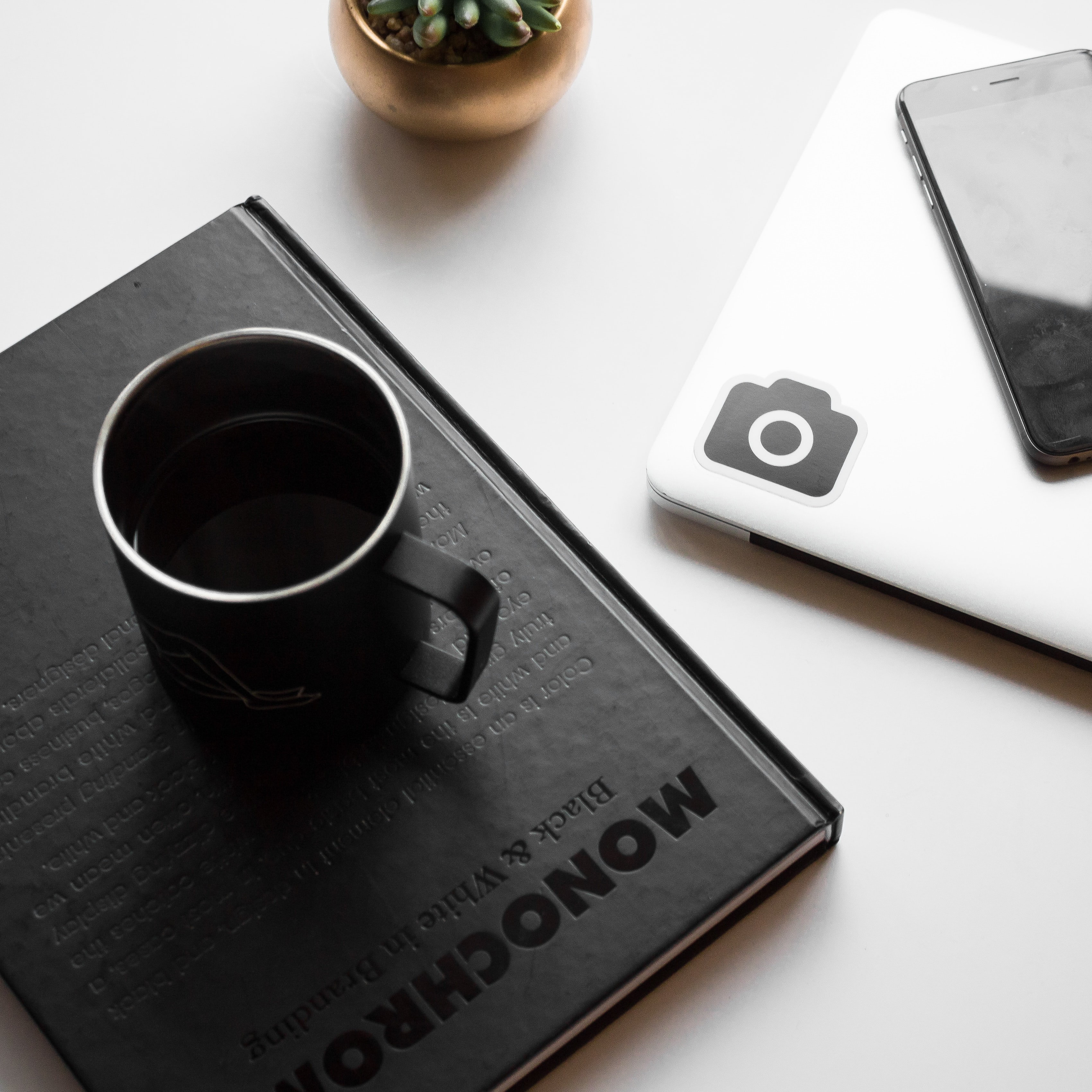 black cup on book