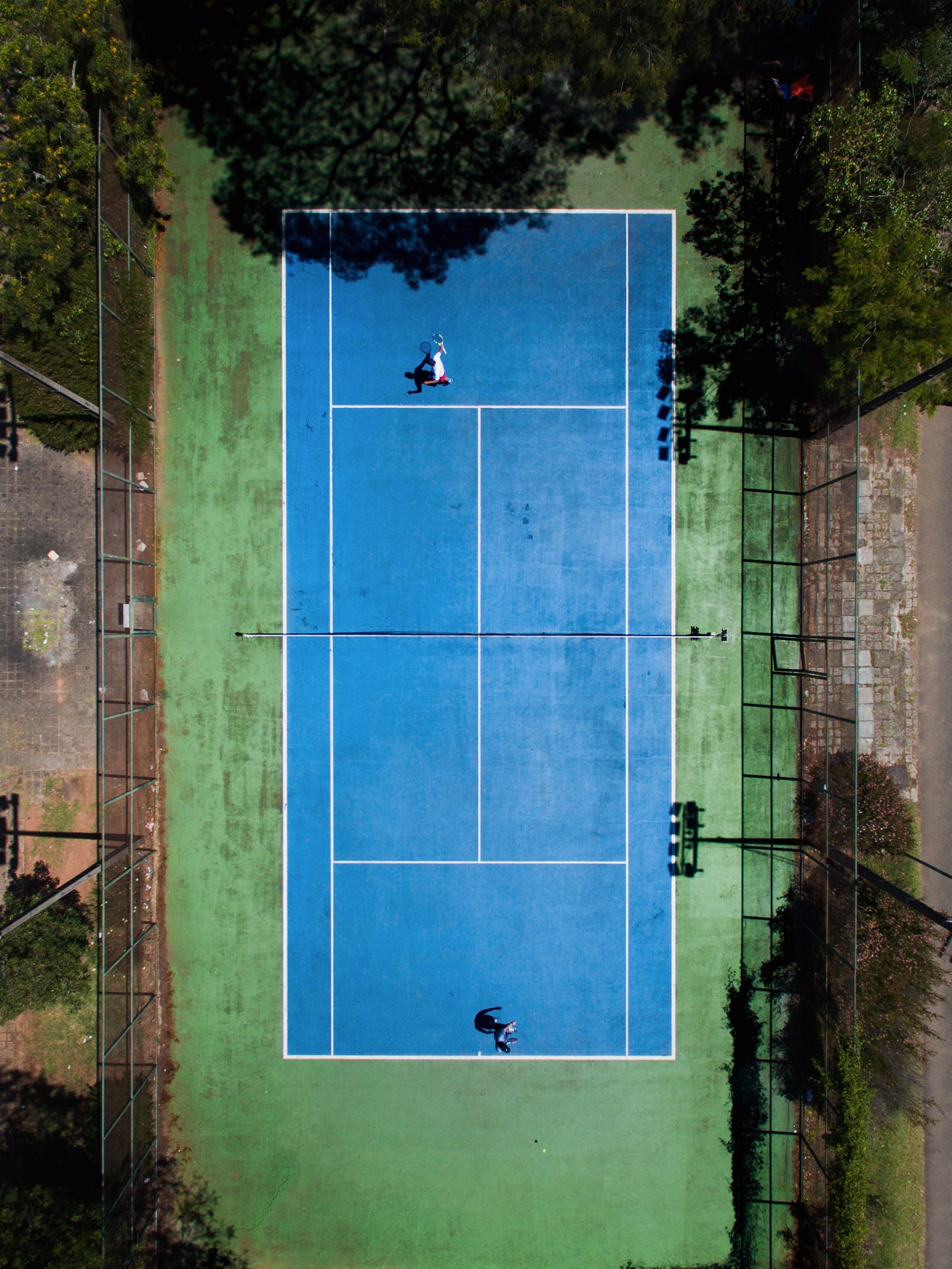 two men playing tennis