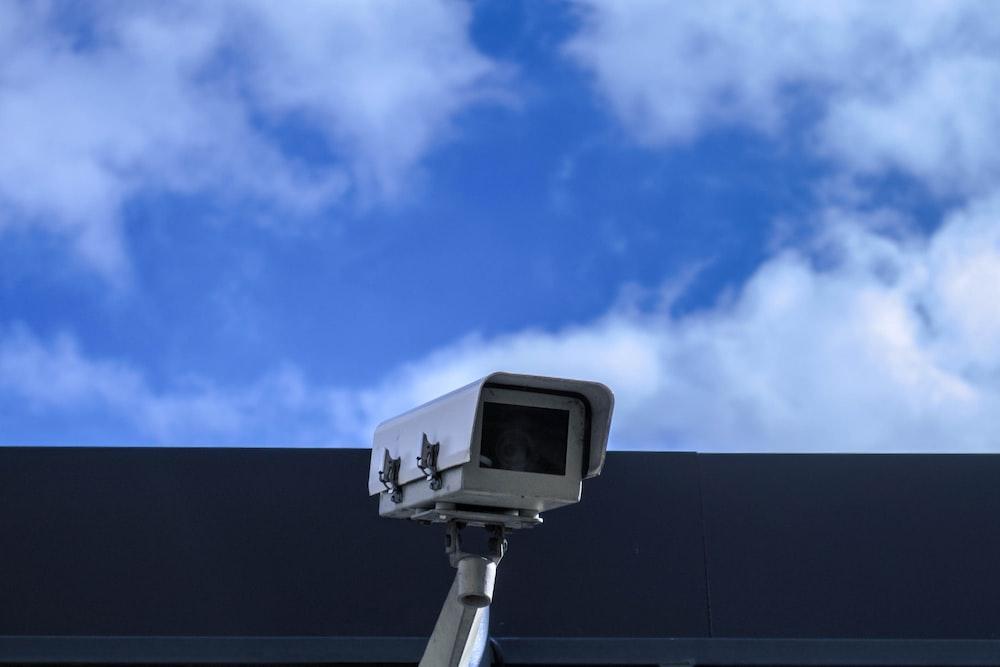 white security camera at daytime