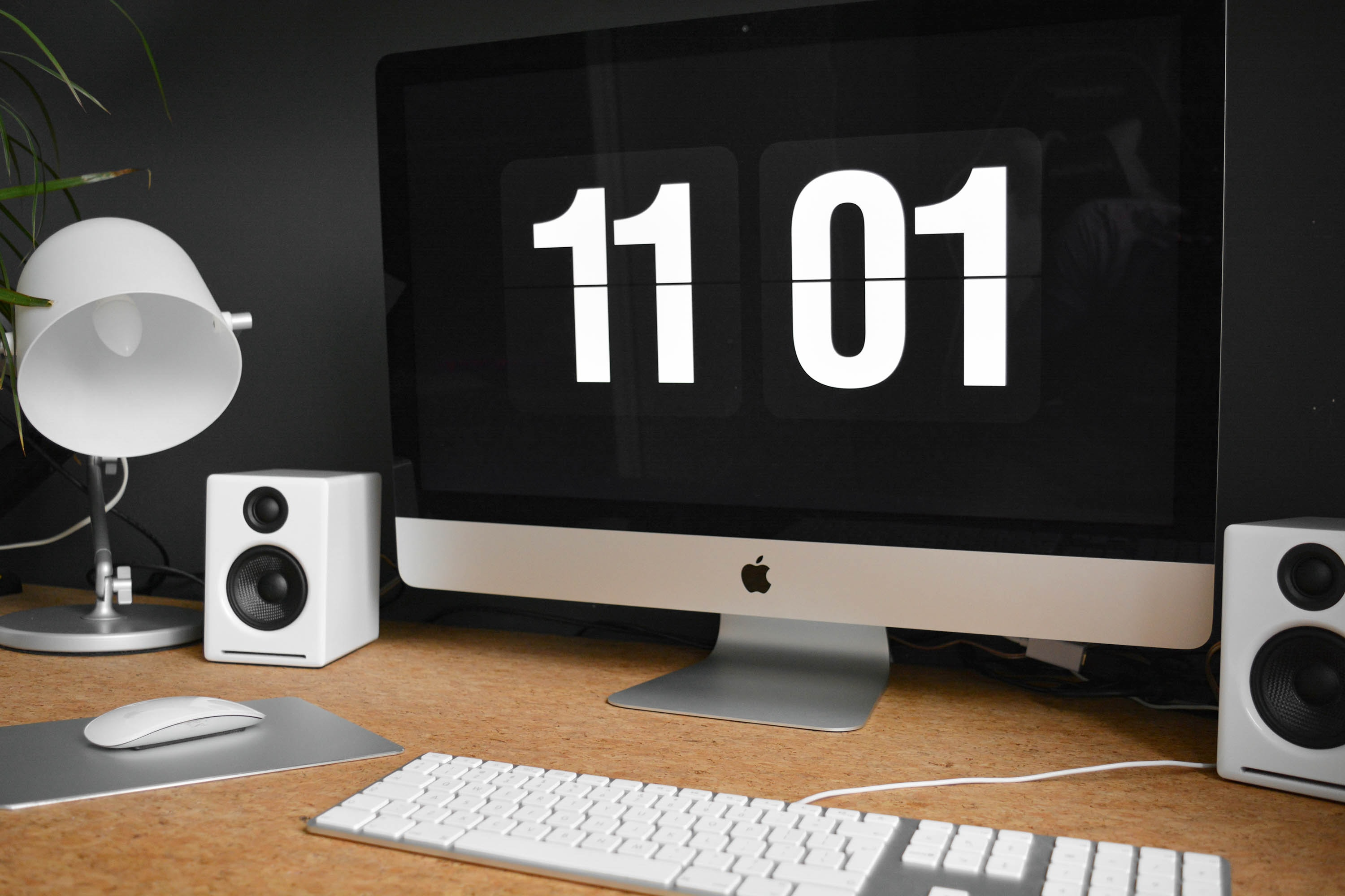 silver iMac with Magic Mouse and Apple Keyboard with Numeric Keypad