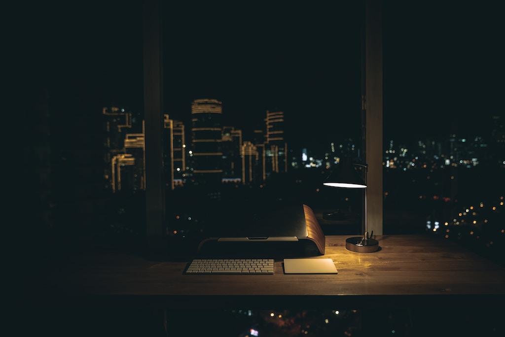lit desk lamp on top of desk lights left on at night wasting energy