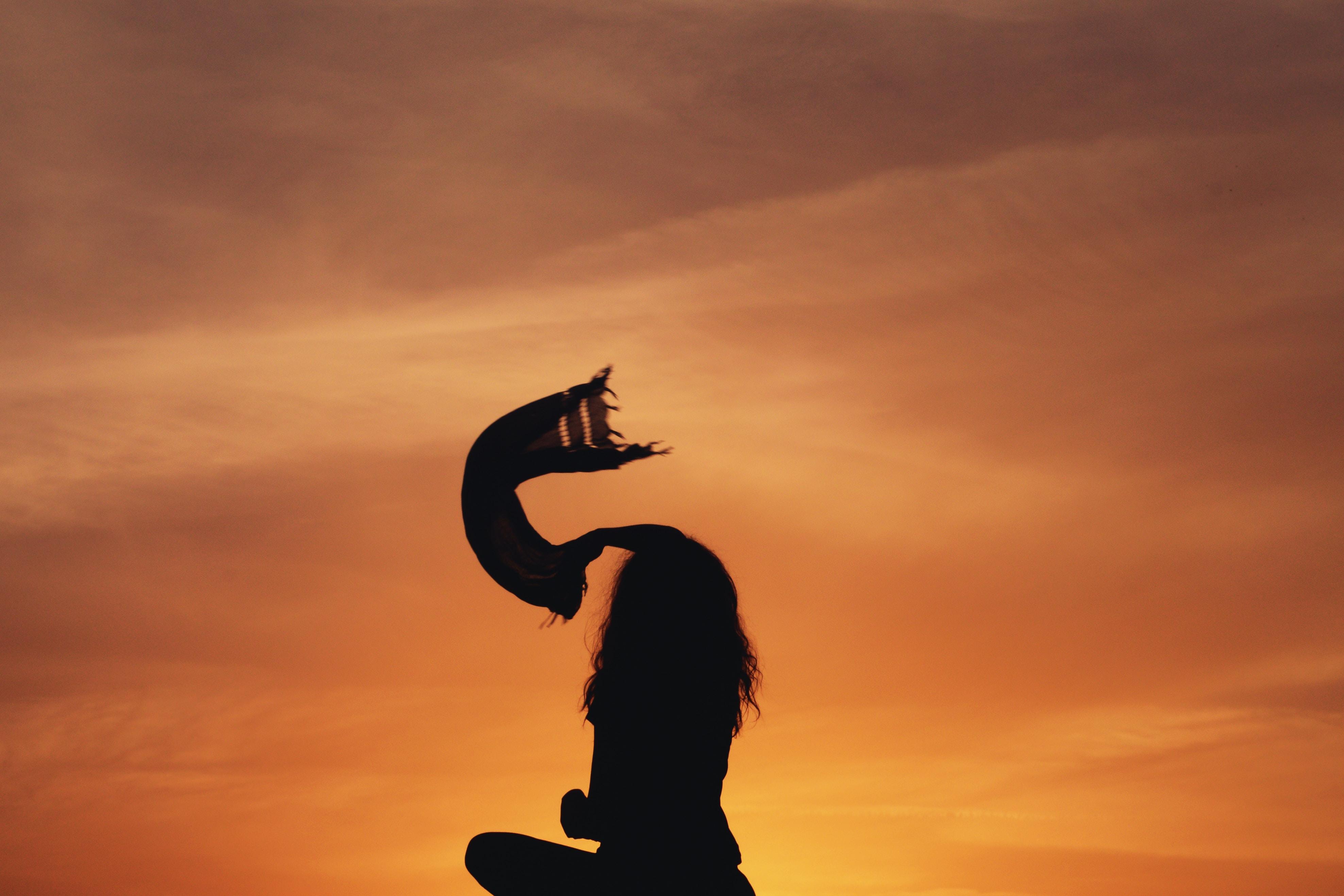 silhouette woman sitting